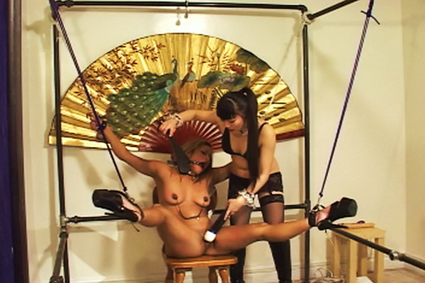 Tied to a metal frame  yumi ties her mistress spreadeagle to a metal frame. Yumi ties her femdom spread-eagle to a metal frame