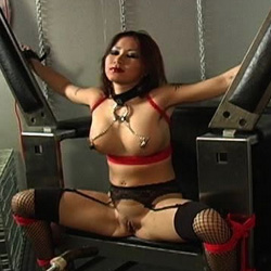 Horny asian slave. This asian bondage scene features a hot asian sex slave bound up in a machine.