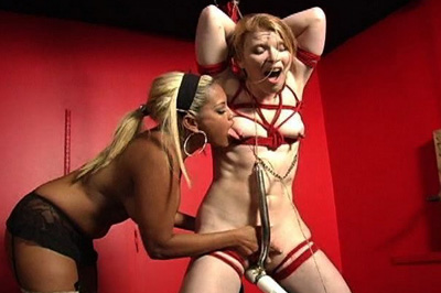Exciting slave roped. The rope was cutting across her small boobs and her mistress even made sure to clamp those nipples up for more tit punishments