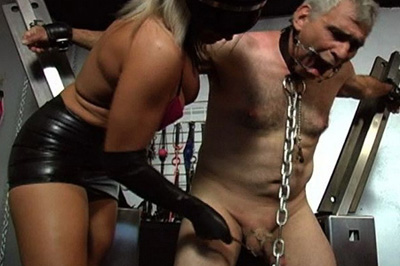 Slave on bdsm cross. He is tied up in a steel x-cross, which allows him to sit if his femdom allowed him to